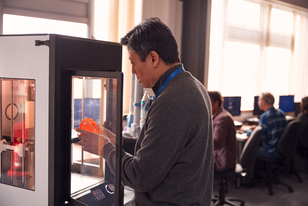 Male Employee Looking at 3D Printed Part